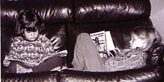 2006-reading_on_couch2.jpg - 20485 Bytes